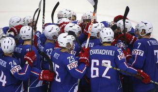 France's players celebrate their victory  during the Group A preliminary round match against Denmark at the Ice Hockey World Championship in Minsk, Belarus, Monday, May 19, 2014. (AP Photo/Sergei Grits)
