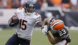 "FILE - In this Dec. 15, 2013 file photo, Chicago Bears wide receiver Brandon Marshall (15) pushes Cleveland Browns cornerback Joe Haden (23) away after a catch in the second quarter of an NFL football game, in Cleveland. The Bears have agreed to terms with Pro Bowl wide receiver Brandon Marshall on a three-year contract extension. It is worth a reported $30 million, and Marshall's foundation tweeted Monday, May 19, 2014, that he was donating $1 million to the ""mental health community."" (AP Photo/Tony Dejak, File)"