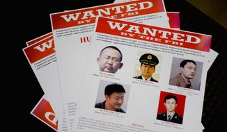 Indicted: Five members of an elite Chinese army group have been charged with conspiracy to commit computer fraud and abuse. Attorney General Eric H. Holder Jr. accuses them of hacking U.S. corporations and labor organizations. (Andrew Harnik/The Washington Times)