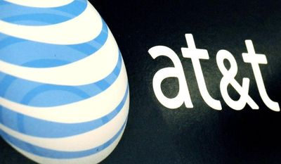 ** FILE ** In this Oct. 19, 2009, file photo, the AT&T logo is on display at a RadioShack store in Gloucester, Mass. (AP Photo/Lisa Poole, File)