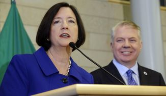 Former Boston police commissioner Kathleen O'Toole left, speaks after being introduced by Seattle Mayor Ed Murray, right, as his nominee to be Seattle's new Chief of Police, Monday, May 19, 2014, in Seattle. (AP Photo/Ted S. Warren)