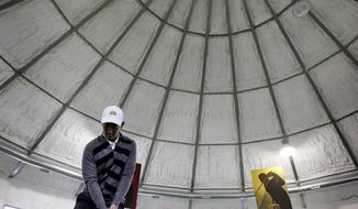 Iowa State golfer Ruben Sondjaja practices putting in a modified grain storage bin in the school's Golf Performance Center, Monday, May 19, 2014, in Ames, Iowa. Iowa State is headed to the NCAA tournament for the first time in 61 years, snapping one of the longest droughts. (AP Photo/Charlie Neibergall)