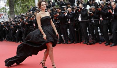 Performer Cheryl Cole poses for photographers as she arrives for the screening of Foxcatcher at the 67th international film festival, Cannes, southern France, Monday, May 19, 2014. (AP Photo/Thibault Camus)