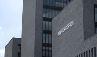 """Exterior view of the Europol headquarters in The Hague, Netherlands, Monday, May 19, 2014. European law enforcement agencies say they have helped coordinate raids in 16 countries that led to 97 arrests of people suspected of developing, distributing or using criminal software known as """"BlackShades."""" Coordination agencies Europol and Eurojust, based in The Hague, Netherlands, said Monday national police in the Netherlands, Belgium, France, Germany, Britain, Finland, Austria, Estonia, Denmark, Italy, Croatia, the United States, Canada, Chile, Switzerland and Moldova carried out 359 raids in all. (AP Photo/Mike Corder)"""