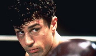 "FILE - This 1980 undated handout file photo shows Robert De Niro as Jake La Motta in a boxing scene from Martin Scorsese's film ""Raging Bull.""  The Supreme Court ruled Monday that a copyright dispute over the 1980 Oscar-winning movie ""Raging Bull"" can go another round in court. The justices said in a 6-3 decision that Paula Petrella, daughter of the late screenwriter Frank Petrella, did not wait too long to file her lawsuit against Metro-Goldwyn-Mayer claiming an interest in the film. (AP Photo, File)"