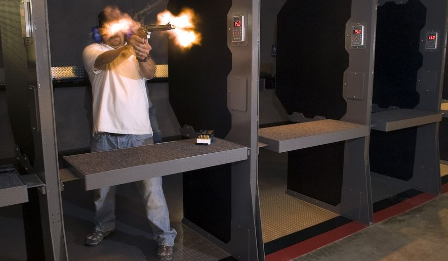 In an undated photo made with a remote camera, Field Time Target & Training operations manager Craig Caringella is obscured by the muzzle blast  while  firing a .500 S&W Magnum revolver at the new Stanton shooting in Stanton, Calif.  The gun range can accommodate all pistols in addition to powerful rifles.  (AP Photo/The Orange County Register, Jebb Harris )   MAGS OUT; LOS ANGELES TIMES OUT