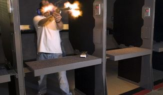 In an undated photo made with a remote camera, Field Time Target & Training operations manager Craig Caringella is obscured by the muzzle blast  while  firing a .500 S&W Magnum revolver at the new Stanton shooting in Stanton, Calif.  The range can accommodate all pistols in addition to powerful rifles.  (AP Photo/The Orange County Register, Jebb Harris )   MAGS OUT; LOS ANGELES TIMES OUT