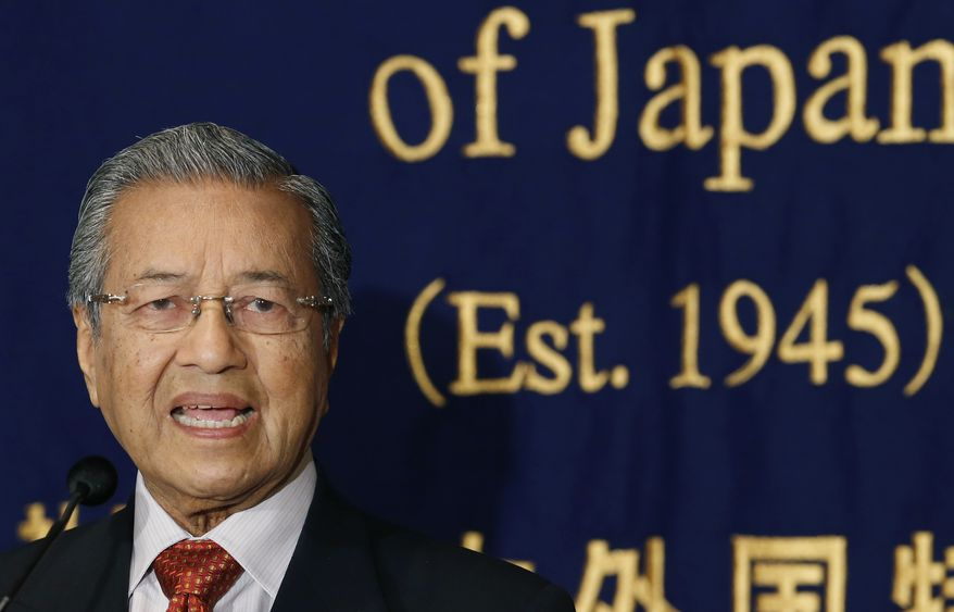 **FILE** Former Malaysian Prime Minister Mahathir Mohamad speaks during a press conference in Tokyo on May 25, 2013. (Associated Press)