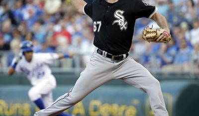 Chicago White Sox starting pitcher Scott Carroll throws during the first inning of a baseball game against the Kansas City Royals on Monday, May 19, 2014, in Kansas City, Mo. (AP Photo/Charlie Riedel)