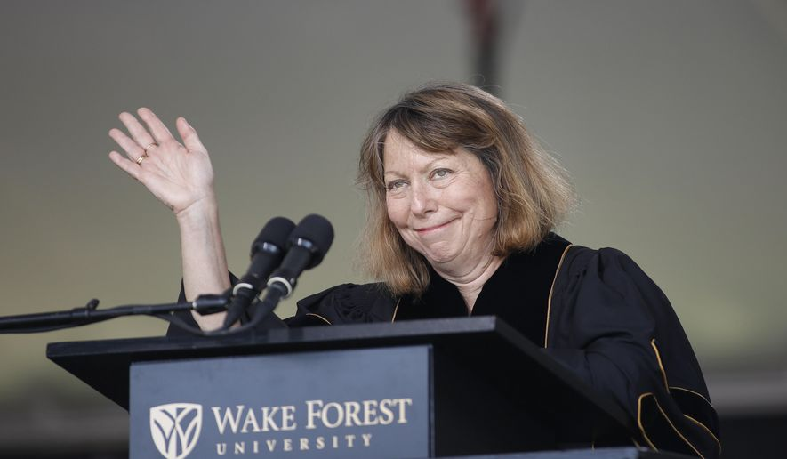 Jill Abramson, former executive editor of The New York Times, waves as she speaks at the commencement ceremony at Wake Forest University in Winston-Salem, N.C., Monday, May 19, 2014. (AP Photo/Nell Redmond)