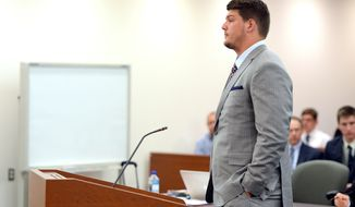 Former Michigan football player and current Tennessee Titan NFL player Taylor Lewan stands in 15th District Court, Monday, May 19. 2014,  in downtown Ann Arbor, Mich. Lewan's pretrial hearing was adjourned until June 16 at the request of his attorney. (AP Photo/The Ann Arbor News, Melanie Maxwell) LOCAL TV OUT; LOCAL INTERNET OUT.