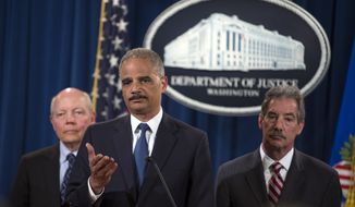 IRS Commissioner John Koskinen, left, and Deputy Attorney General James Cole, right, watch as Attorney General Eric Holder speaks during a news conference at the Justice Department, on Monday, May 19, 2014, in Washington. The Justice Department on Monday charged Credit Suisse AG with helping wealthy Americans avoid paying taxes through offshore accounts, and a person familiar with the matter said the European bank has agreed to pay about $2.6 billion in penalties. (AP Photo/ Evan Vucci)