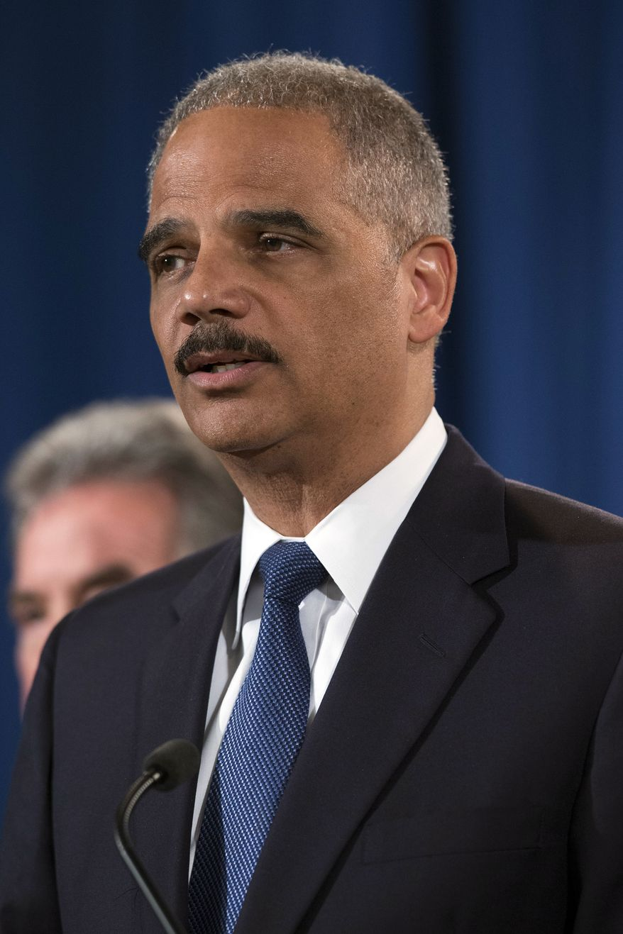 Attorney General Eric Holder speaks during a news conference at the Justice Department, on Monday, May 19, 2014, in Washington. The Justice Department on Monday charged Credit Suisse AG with helping wealthy Americans avoid paying taxes through offshore accounts, and a person familiar with the matter said the European bank has agreed to pay about $2.6 billion in penalties. (AP Photo/ Evan Vucci)