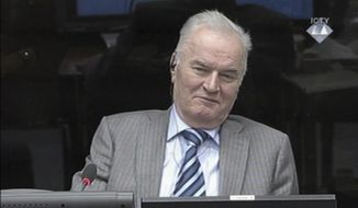 FILE - In this Jan. 28, 2014 file image taken from video former Bosnian Serb military chief Gen. Ratko Mladic smiles during his appearance at the Yugoslav war crimes tribunal in the Hague, Netherlands. On Monday, May 19, 2014 Mladic has launched the defense case in his long-running U.N. trial by calling a former Serb army officer who claims he was never ordered to fire on civilians in the besieged Bosnian capital. The 72-year-old Mladic denies 11 charges of ordering Serb atrocities throughout the 1991-95 Bosnian war. He faces a life sentence if convicted. (AP Photo/ICTY, Via Associated Press Television, File) TV OUT
