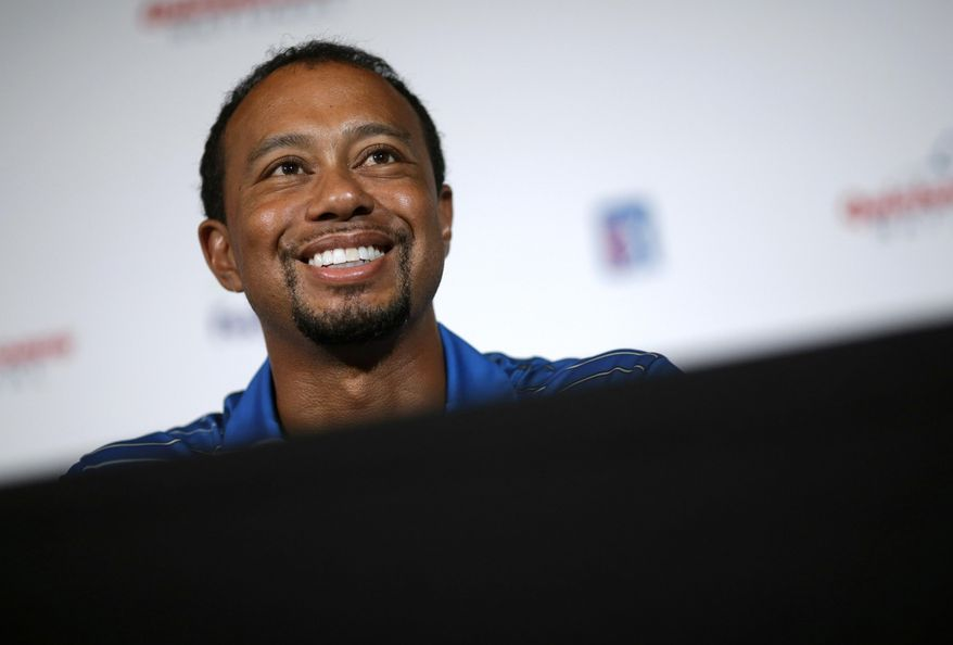 Golfer Tiger Woods speaks at a Quicken Loans National PGA tournament media day news conference at Congressional Country Club, Monday, May 19, 2014, in Bethesda, Md. Woods said his back injury was so debilitating that it caused him to doubt whether he would play golf again. While the surgery he had March 31 erased those doubts, he still has no timetable for his return. (AP Photo/Patrick Semansky)