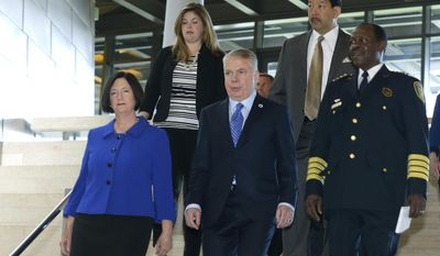 Former Boston police commissioner Kathleen O'Toole front left, walks with her daughter Meghan, upper left, Seattle Mayor Ed Murray, front center, Interim Police Chief Harry Bailey, front right, and city council member Bruce Harrell, upper right, Monday, May 19, 2014, on the way to a press conference in Seattle to introduce O'Toole as Murray's nominee to be the new Seattle Chief of Police. (AP Photo/Ted S. Warren)