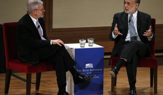 Former Federal Reserve Chief Ben Bernanke, right, answers questions during a discussion with Joshua Bolten, managing director Rock Creek Global Advisors, on Monday, May 19, 2014, at the George W. Bush Presidential Center in Dallas. They discussed monetary policy and the economy. (AP Photo/The Dallas Morning News, David Woo) MANDATORY CREDIT; MAGS OUT; TV OUT; INTERNET USE BY AP MEMBERS ONLY; NO SALES.