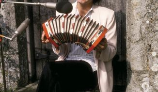 """This 1979 photo provided by Dalton Watson Fine Books shows musician Paul McCartney in the new book, """"Guitar With Wings: A Photographic Memoir,"""" by legendary guitarist Laurence Juber, releasing on Tuesday, May 20, 2014. The 250-plus page work has more than 200 previously unpublished images, including those of Juber, McCartney and Wings, a spokesman for Juber said Monday. (AP Photo/Dalton Watson Fine Books, Laurence Juber)"""