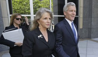 Former Virginia Gov. Bob McDonnell, right, and his wife Maureen, center, leave Federal court  after a motions hearing in Richmond, Va., Monday, May 19, 2014.  The Republican former governor and his wife are charged in a 14-count indictment with accepting more than $165,000 from Jonnie Williams, the former CEO of dietary supplements maker Star Scientific Inc., in exchange for helping promote his products. They have pleaded not guilty. (AP Photo/Steve Helber)