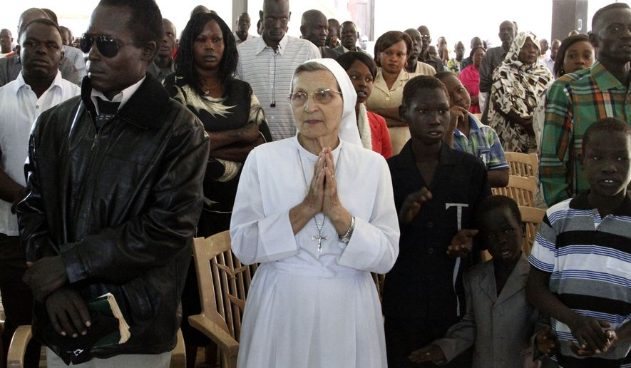 Christian worshipers pray during Christmas mass at a Church in Khartoum, Sudan, Wednesday, Dec. 25, 2013. (AP Photo/Abd Raouf)