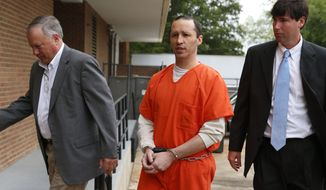 FILE- In this May 13, 2014 file photo, James Everett Dutschke, center, is lead by U.S. Marshalls into the Federal Building in Aberdeen, Miss. Dutschke, who pleaded guilty to sending letters dusted with the poison ricin to President Barack Obama and other officials, was sentenced Monday, May 19, 2014, to 25 years in prison. (AP Photo/Northeast Mississippi Daily Journal, Thomas Wells, File) MANDATORY CREDIT