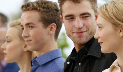 From right, actress Mia Wasikowska, actor Rob Pattinson, actor Evan Bird and actress Sarah Gadon pose for photographers during a photo call for Maps to the Stars at the 67th international film festival, Cannes, southern France, Monday, May 19, 2014. (AP Photo/Alastair Grant)