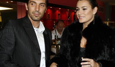 "FILE - In this in this Nov. 25, 2006 file photo Czech top model Alena Seredova, right, and her partner, Juventus Turin goalkeeper Gianluigi Buffon, left, attend the premiere of a musical at Prague's Hybernia Theatre. Italy captain Gianluigi Buffon's announcement that he is separating from his wife caught coach Cesare Prandelli off guard as the Azzurri opened their World Cup training camp Tuesday, May 20, 2014. Prandelli says he was ""surprised by his statement. ... I'm sorry, because whenever there's a separation it's upsetting for everyone. But the serenity with which he made the announcement leads to believe that he's mentally ready for this event."" Buffon, whose personal life has been under an intense spotlight in recent weeks, told Sky TV he has been ""separated for a while"" from Czech model Alena Seredova, who he married three years ago. The couple has two boys. Buffon is preparing to play at his ninth major international tournament, moving him level with former Germany great Lothar Matthaus as the top Europeans.  (AP Photo/CTK, Roman Vondrous, Files)"