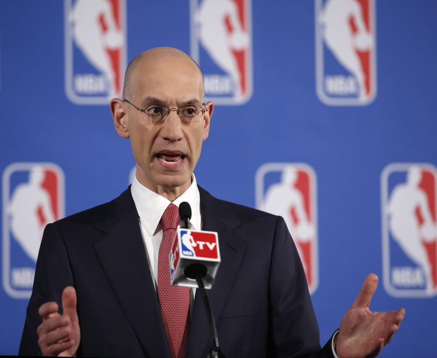 NBA Commissioner Adam Silver gestures as he answers reporters' questions during a press conference before the NBA Draft Lottery in New York, Tuesday, May 20, 2014.  (AP Photo/Kathy Willens)