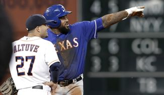 Texas Rangers' Prince Fielder, right, points out the replay video to Houston Astros second baseman Jose Altuve (27) during a review of a play in the fourth inning of a baseball game Tuesday, May 13, 2014, in Houston. Fielder had tried to stretch a single, and after a review of the close play was called out at second. (AP Photo)