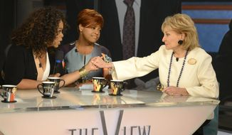 "This Thursday, May 15, 2014 photo released by ABC shows, Oprah Winfrey, left, grasping hands with Barbara Walters, right, as co-host Sherri Shepherd looks on during a taping of Walters' final co-host appearance on ""The View,"" in New York. Thanks to Justin Timberlake and Walters, ABC is enjoying its second-best week in the ratings so far this year. An estimated 9.5 million people watched ABC's two-hour salute to retiring TV news legend Walters on Friday, May 16, 2014, the biggest audience the network has received in that time slot in two years. (AP Photo/ABC, Ida Mae Astute)"