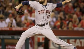 Houston Astros starting pitcher Dallas Keuchel throws to the Los Angeles Angels during the fourth inning of a baseball game in Anaheim, Calif., Monday, May 19, 2014. (AP Photo/Chris Carlson)