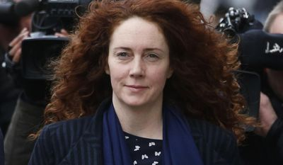 "FILE - This is a Wednesday, Feb. 19, 2014 file photo of Rebekah Brooks, the former News International chief executive, arrives at the Central Criminal Court in London where she appears to face charges related to phone hacking. Brooks' lawyer has told the jury at Britain's phone-hacking trial on Tuesday May 20, 2014 that they must ignore the ""inaccuracy and bias ... cruelty and vitriol"" written about his client as they consider their verdicts. Jonathan Laidlaw said Tuesday that prosecutors had produced ""no smoking gun"" to convict former News of the World editor Brooks, who is accused of conspiring to hack phones, pay officials for information and obstruct a police investigation. (AP Photo/Sang Tan, File)"