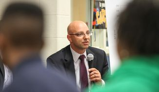 Chris Barbic, the superintendent of the state Achievement School District, participates in a discussion about improving K-12 education at Brick Church College Prep in Nashville, Tenn., on Tuesday, May 20, 2014. Under state law, the state can run the worst-performing 5 percent of schools. The event also featured U.S. Education Secretary Arne Duncan. (AP Photo/Erik Schelzig)