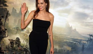 """FILE - In this Tuesday, May 6, 2014 file photo, actress Angelina Jolie poses during a photocall for the film """"Maleficent"""" (Malefique) in Paris. The film releases in theaters in the U.S. on May 30, 2014. (AP Photo/Francois Mori, file)"""