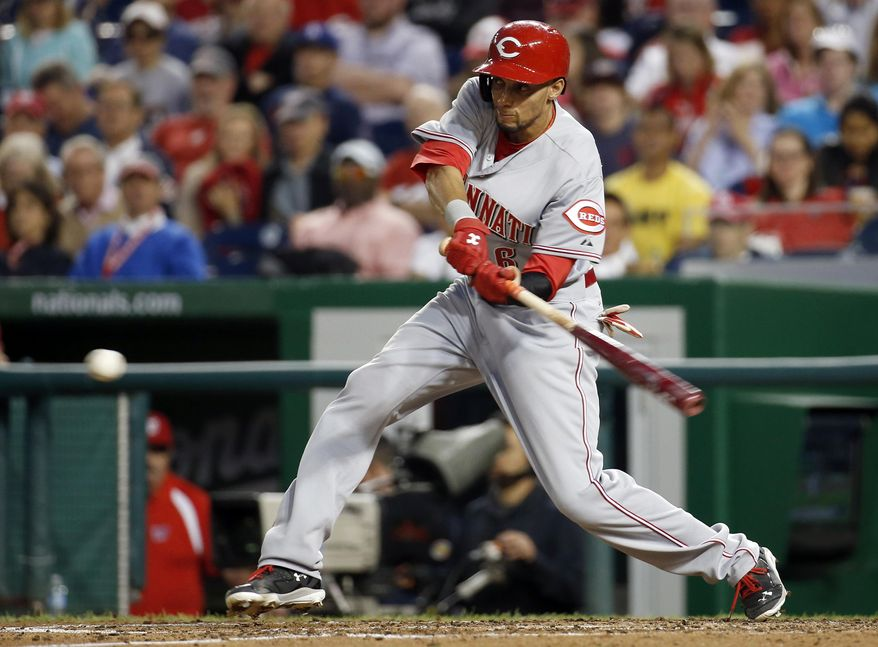 Cincinnati Reds' Billy Hamilton hits a single during the fifth inning of a baseball game against the Washington Nationals at Nationals Park Monday, May 19, 2014, in Washington. (AP Photo/Alex Brandon)