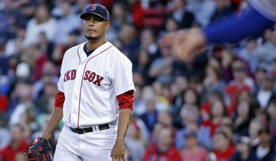 Boston Red Sox starting pitcher Felix Doubront watches a two-run homer by Toronto Blue Jays' Edwin Encarnacion stay fair in the third inning of a baseball game at Fenway Park in Boston, Tuesday, May 20, 2014. (AP Photo/Elise Amendola)