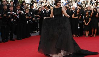 Actress Sonam Kapoor poses for photographers as she arrives for the screening of The Homesman at the 67th international film festival, Cannes, southern France, Sunday, May 18, 2014. (AP Photo/Alastair Grant)