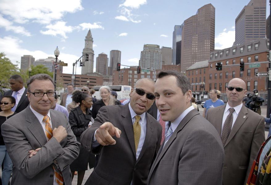 Massachusetts Gov. Deval Patrick talks with Rep. Aaron Michlewich, D-Boston, right, as Boston City Councillor Sal LaMttina looks on, left,  before a ceremony to honor Zipporah Potter Atkins, the first African-American to purchase property in Boston, near where her house stood Tuesday, May 20, 2014 in Boston. Atkins bought here house in 1670 in an area on the edge of what is today known as Boston's North End. (AP Photo/Stephan Savoia)