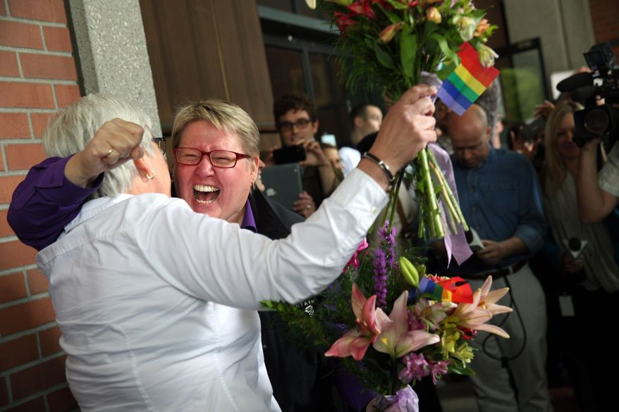 Deanna Geiger, left, and Janine Nelson, her partner of 32 years, react to news that they can get their Oregon marriage license, Monday, May 19, 2014, in Portland, Ore., following a federal judge's ruling the ban of same-sex marriage unconstitutional.  (AP Photo/The Oregonian, Faith Cathcart)  MAGS OUT; TV OUT; LOCAL TV OUT; LOCAL INTERNET OUT; THE MERCURY OUT; WILLAMETTE WEEK OUT; PAMPLIN MEDIA GROUP OUT.
