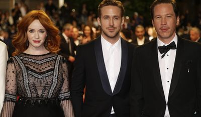 The cast of Lost River, including actress Christina Hendricks, left, director Ryan Gosling, center, and actor Reda Kateb pose for photographers as they arrive for the screening of Coming Home (Gu Lai) at the 67th international film festival, Cannes, southern France, Tuesday, May 20, 2014. (AP Photo/Thibault Camus)
