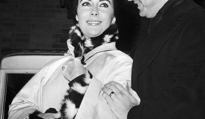 ELIZABETH TAYLOR-Eddie Fisher left his first wife, actress Debbie Reynolds, to marry Reynolds' best friend, actress Elizabeth Taylor, when Taylor's husband, film producer Mike Todd, died. This event garnered scandalous and unwelcome publicity for Fisher.  Photo shows British actress Elizabeth Taylor is helped by her husband American singer Eddie Fisher, as she leaves Presbyterian hospital in New York, United States on Dec. 13, 1959, following a bout with double pneumonia. She rode from her room in a wheelchair but walked out with her husband's help. They went to their suite in the Waldorf-Astoria Hotel. The actress entered the hospital on Nov. 26, 1959. (AP Photo)