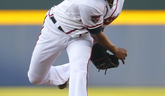 Atlanta Braves starting pitcher Julio Teheran delivers in the first inning of a baseball game against the Milwaukee Brewers on Tuesday, May 20, 2014, in Atlanta. (AP Photo/Todd Kirkland)