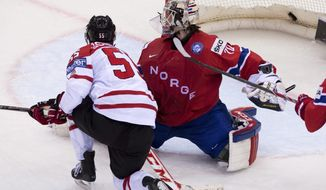 Team Canada's Mark Scheifele scores the second goal on Norway's Steffen Soberg during second period action on Tuesday, May 20, 2014 at the IIHF World Hockey Championship in Minsk,  Belarus. (AP Photo/The Canadian Press, Jacques Boissinot)