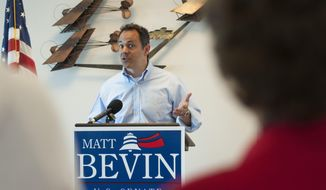 U.S. Senate candidate Matt Bevin speaks to supporters Monday, May 19, 2014, at a fly-in at the Bowling Green-Warren County Regional Airport in Bowling Green, Ky.  (AP Photo/Daily News, Miranda Pederson)