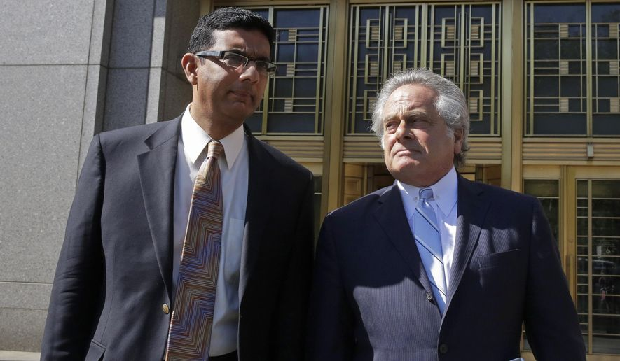 Conservative scholar and filmmaker Dinesh D'Souza, left, accompanied by his lawyer Benjamin Brafman leave federal court, in New York,  Tuesday, May 20, 2014. (AP Photo/Richard Drew) ** FILE **