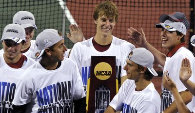 USC and Max de Vroome, center, celebrates their men's team NCAA Division I tennis championships after defeating Oklahoma, Tuesday, May 20, 2014, in Athens, Ga. (AP Photo/David Tulis)
