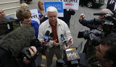 Pennsylvania Gov. Tom Corbett, center, talks with reporters outside his polling place at the Shaler Villa Volunteer Fire Company after voting in the Pennsylvania primary election on Tuesday, May 20, 2014 in the Pittsburgh suburb of Shaler Towhnship, Pa.(AP Photo/Keith Srakocic)