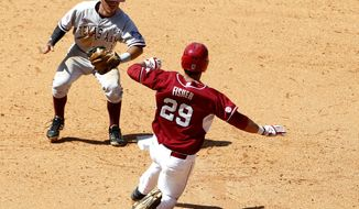 Arkansas' Eric Fisher (29) is tagged out by Texas A&M's Blake Allemand as he slides into second base during the eighth inning of an NCAA college baseball game in the Southeastern Conference tournament Tuesday, May 20, 2014, in Hoover, Ala. (AP Photo/Butch Dill)