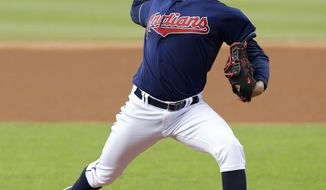 Cleveland Indians starting pitcher Trevor Bauer delivers in the first inning of a baseball game against the Detroit Tigers, Tuesday, May 20, 2014, in Cleveland. (AP Photo/Tony Dejak)