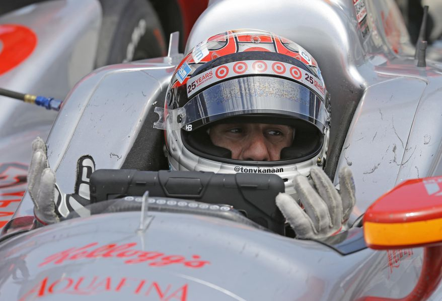 Tony Kanaan, of Brazil, talks with his crew over the radio as he sits in the car in the pit area during practice for the Indianapolis 500 IndyCar auto race at the Indianapolis Motor Speedway in Indianapolis, Monday, May 19, 2014. (AP Photo/Michael Conroy)